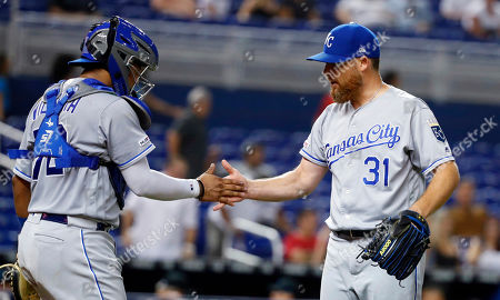 Meibrys Viloria, Ian Kennedy. Kansas City Royals relief pitcher Ian Kennedy (31) and catcher Meibrys Viloria (72) celebrate after they defeated the Miami Marlins in a baseball game, in Miami
