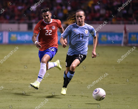 Stock Picture of Uruguay's Diego Laxalt, center, is chased by Costa Rica's Ronald Matarrita during a friendly soccer match at the National Stadium in San Jose, Costa Rica