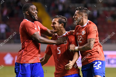 Stock Photo of Costa Rica's Celso Borges, center, is congratulated by teammates Ronald Matarrita, right, and Joel Campbell after scoring against Uruguay during a friendly soccer match at the National Stadium in San Jose, Costa Rica