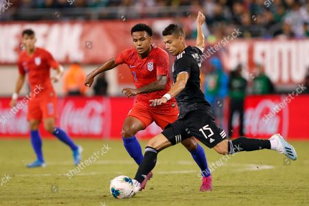 Hecror Moreno, Weston McKennie. Mexico defender Hector Moreno (15) controls the ball as U.S. midfielder Weston Mckennie (8) defends during the first half of an international friendly soccer match, in East Rutherford, NJ