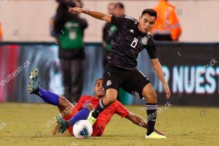 Carlos Rodriguez, Reggie Cannon. Mexico midfielder Carlos Rodriguez (8) steals the ball from U.S. defender Reggie Cannon during the second half of an international friendly soccer match, in East Rutherford, N.J. Mexico won 3-0