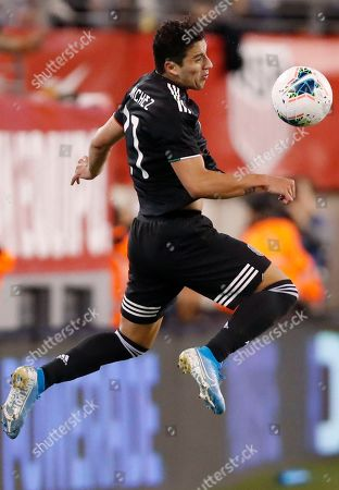 Mexico forward Javier Hernandez (14) goes airborne for a pass during the second half of the team's international friendly soccer match against the United States, in East Rutherford, N.J. Mexico won 3-0