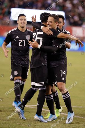 Javier Hernandez, Juriel Antuna, Jorge Sanchez. Mexico forward Javier Hernandez (14) embraces midfielder Uriel Antuna (26) after Antuna scored Mexico's third goal, in the second half of an international friendly soccer match against the United States, in East Rutherford, N.J. Jorge Sanchez is at left. Mexico won 3-0