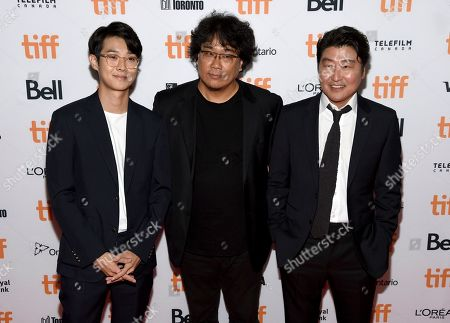 "Choi Woo-shik, Bong Joon-ho, Song Kang-ho. Choi Woo-shik, from left, director Bong Joon-ho and Song Kang-ho attend the premiere for ""Parasite"" on day two of the Toronto International Film Festival at the Ryerson Theatre, in Toronto"