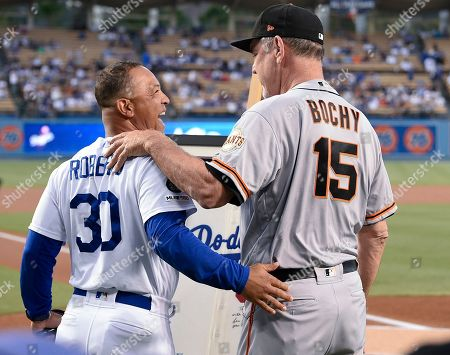 Bruce Bochy, Dave Roberts. San Francisco Giants manager Bruce Bochy, right, embraces Los Angeles Dodgers manager Dave Roberts after being given a signed Sandy Koufax jersey to commemorate his last series with the Giants at Dodger Stadium, in Los Angeles