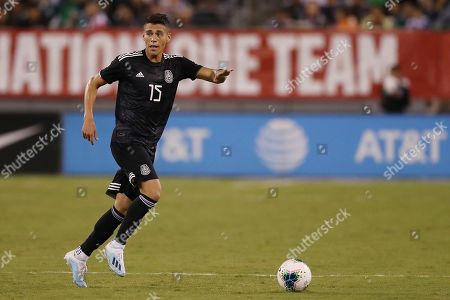 Mexico defender Hector Moreno moves the ball up the pitch during an international friendly soccer match against the the United States, in East Rutherford, N.J. Mexico won 3-0