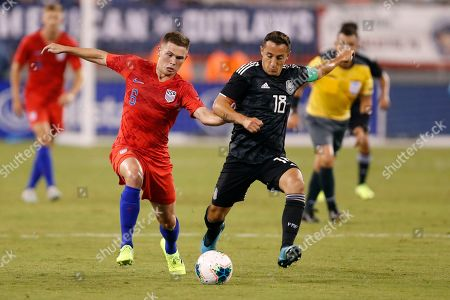United States midfielder Wil Trapp (6) competes againt Mexico midfielder Andres Guardado (18) in the first half of an international friendly soccer match, in East Rutherford, NJ