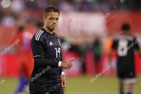 Mexico forward Javier Hernandez gives a thumbs up to a teammate during an international friendly soccer match against the the United States, in East Rutherford, N.J. Mexico won 3-0