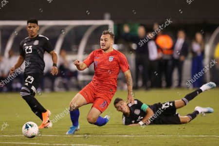 United States forward Jordan Morris, center, comes up short on a goal scoring opportunity while Mexico defender Jesus Gallardo, left, and Mexico defender Hector Moreno watch during an international friendly soccer match, in East Rutherford, N.J. Mexico won 3-0
