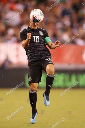 Mexico midfielder Andres Guardado jumps up to head the ball during an international friendly soccer match against the the United States, in East Rutherford, N.J. Mexico won 3-0