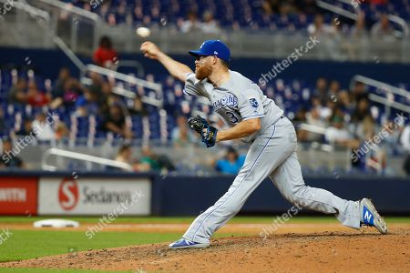 Stock Photo of Kansas City Royals' Ian Kennedy pitches during the ninth inning of a baseball game against the Miami Marlins, in Miami. The Royals defeated the Marlins 3-0