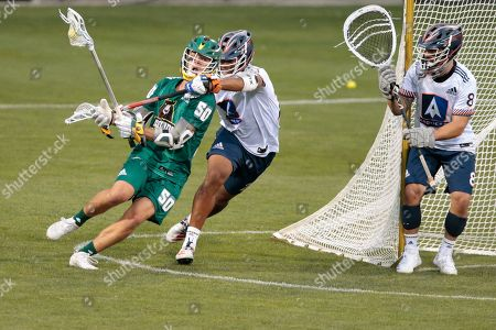 Redwoods Ryder Garnsey (50) gets wrapped up by Archers Dominique Alexander (23) during a Premier Lacrosse League game on in Columbus, Ohio