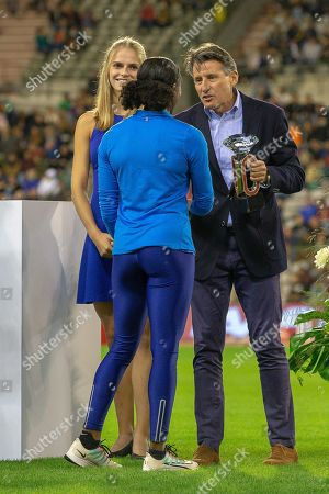 Lord Sebastian Coe, President of the IAAF presents the 2019 Diamond League Trophy for the Women's 100m to Dina Asher-Smith (Great Britain) at the IAAF Diamond League event at the King Baudouin Stadium, Brussels