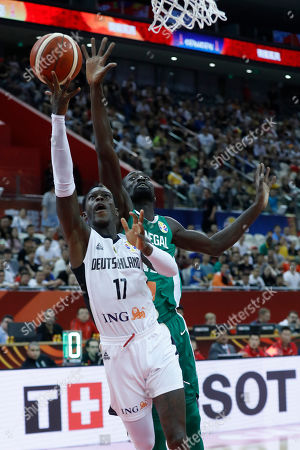 Dennis Schroder of Germany (L) in action  during the FIBA Basketball World Cup 2019 classification ?round? match between Germany and Senegal in Shanghai, China, 07 September 2019.