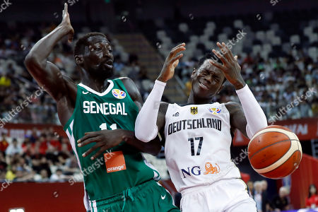 Dennis Schroder of Germany (R) in action against Mouhammad Faye of Senegal during the FIBA Basketball World Cup 2019 classification ?round? match between Germany and Senegal in Shanghai, China, 07 September 2019.