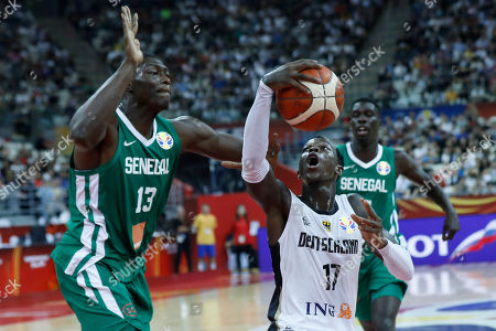 Dennis Schroder of Germany (R) in action against Hamady Ndiaye of Senegal during the FIBA Basketball World Cup 2019 classification ?round? match between Germany and Senegal in Shanghai, China, 07 September 2019.