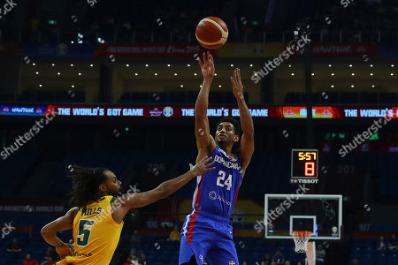 Gelvis Solano (R) of Dominican Republic  in action against  Patty Mills (L) of Australia during the FIBA Basketball World Cup 2019 match between Australia and Dominican Republic in Nanjing, China, 07 September 2019.
