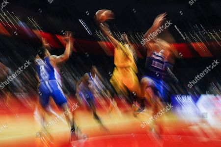 Patty Mills (2-R) of Australia in action during the FIBA Basketball World Cup 2019 match between Australia and Dominican Republic in Nanjing, China, 07 September 2019.