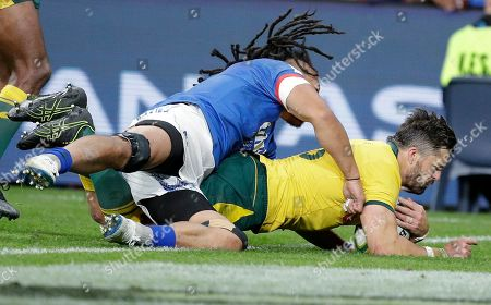 Adam Ashley-Cooper, TJ Ioane. Australia's Adam Ashley-Cooper, right, scores a try as Samoa's TJ Ioane trys to stop him on the goal line during their rugby union test match in Sydney