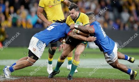 Adam Ashley-Cooper, TJ Ioane, Reynold Lee-Lo. Australia's Adam Ashley-Cooper, center, is tackled by Samoa's TJ Ioane, left, and Samoa's Reynold Lee-Lo during their rugby union test match in Sydney
