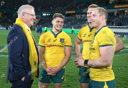 Australian Prime Minister Scott Morrison (left) talks with Australian Wallabies players (L-R) James O'Connor, Dane Haylett-Petty and captain David Pocock after the Australian Wallabies and Manu Samoa International rugby match at Bankwest Stadium in Sydney, Australia, 07 September 2019.