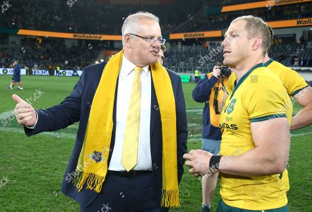 Australian Prime Minister Scott Morrison (left) talks with Wallabies captain David Pocock after the Australian Wallabies and Manu Samoa International rugby match at Bankwest Stadium in Sydney, Australia, 07 September 2019.