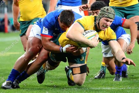 Ed Fidow (L) of Samoa tackles David Pocock of the Wallabies during  the Australian Wallabies and Manu Samoa International rugby match at Bankwest Stadium in Sydney, Australia, 07 September 2019.