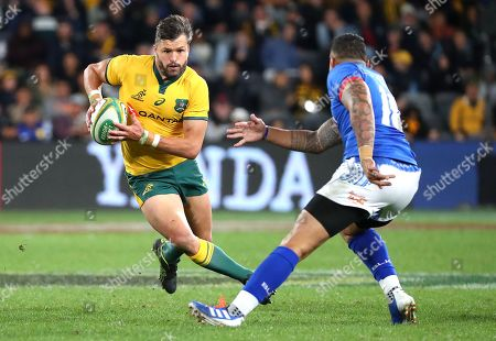 Adam Ashley-Cooper (L) of the Wallabies tries to avoid the tackle of Tusi Pisi of Samoa during the Australian Wallabies and Manu Samoa International rugby match at Bankwest Stadium in Sydney, Australia, 07 September 2019.