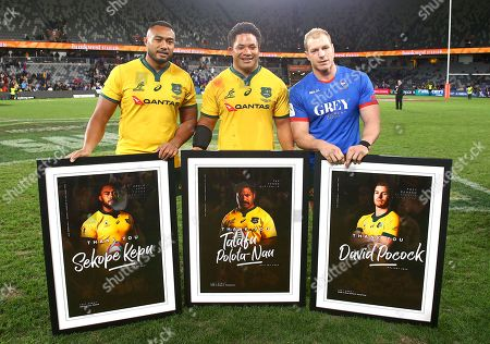Australian Wallabies captain David Pocock (right) poses with teammates Sekope Kepu (left) and Tatafu Polota-Nau after they were presented with photographs after the Australian Wallabies and Manu Samoa International rugby match at Bankwest Stadium in Sydney, Australia, 07 September 2019.