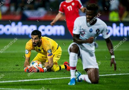 Goalkeeper Rui Patricio of Portugal takes te ball