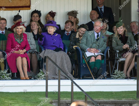 Stock Image of Queen Elizabeth II joined by Camilla Duchess of Cornwall, Prince Charles and Autumn Phillips watch the sack race.