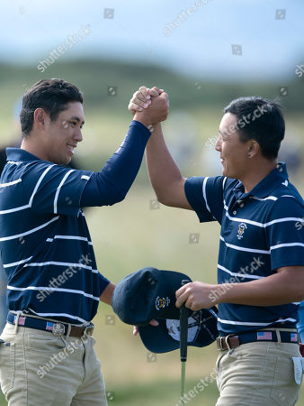 John Pak, right, and Isaiah Salinda of the USA team celebrate after winning their foursomes match against Sandy Scott and Euan Walker of the Great Britain & Ireland team at the Walker Cup golf trophy between the United States and the Great Britain and Ireland team at Royal Liverpool Golf Club in Hoylake, England
