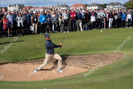 Stock Image of John Pak of the USA Team plays out of a bunker on the 16th hole during his foursomes win with teammate Isaiah Salinda against Sandy Scott and Euan Walker of the Great Britain & Ireland team at the Walker Cup golf trophy between the United States and the Great Britain and Ireland team at Royal Liverpool Golf Club in Hoylake, England
