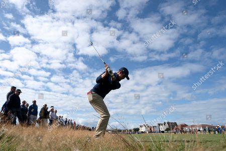 Alex Smalley of the USA Team plays a shot on the 17th hole during his foursomes win with teammate Brandon Wu against Tom Sloman and Thomas Plumb of the Great Britain & Ireland team at the Walker Cup golf trophy between the United States and the Great Britain and Ireland team at Royal Liverpool Golf Club in Hoylake, England