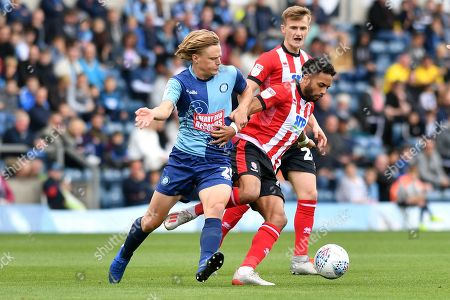 Wycombe's Alex Samuel (25) and Lincoln's Bruno Andrade (11) during the EFL Sky Bet League 1 match between Wycombe Wanderers and Lincoln City at Adams Park, High Wycombe