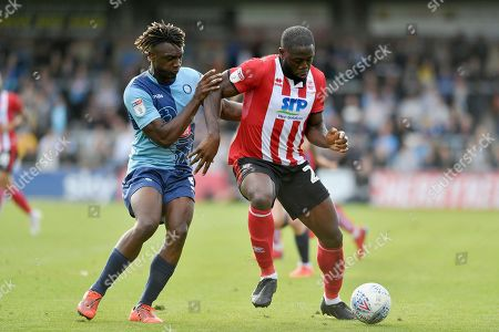 Stock Photo of Wycombe Wanderers Anthony Stewart (5) and Lincoln City's John Akinde (29) during the EFL Sky Bet League 1 match between Wycombe Wanderers and Lincoln City at Adams Park, High Wycombe