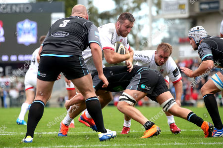 Stock Image of Ulster vs Glasgow Warriors. Ulster's Alan O'Connor is tackled by Matt Smith of Glasgow
