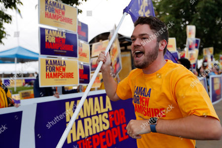 "Craig Brown of Manchester, N.H., leads a cheer of ""It's time for a woman in the White House,"" while rallying for Democratic presidential candidate Sen. Kamala Harris, D-Calif., before the New Hampshire state Democratic Party convention, in Manchester, NH"