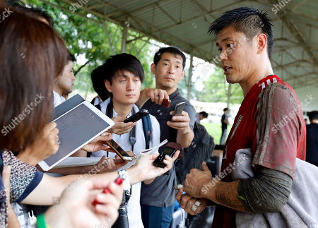 Stock Image of Japanese national soccer team goalkeeper Eiji Kawashima (R) talks to journalists during his team's training session in Yangon, Myanmar, 07 September 2019. Japan will face Myanmar in their FIFA World Cup 2022 qualifying group F soccer match on 10 September 2019.