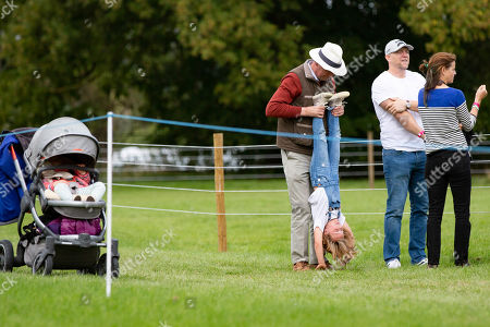 Tim Laurence, Mia Grace Tindall and Mike Tindall