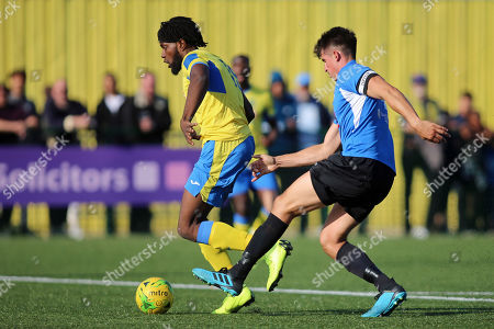 Chid Onokwai of Haringey and Laurence Harvey of Herne Bay during Haringey Borough vs Herne Bay, Emirates FA Cup Football at Coles Park Stadium on 7th September 2019