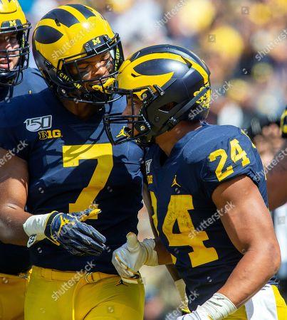 Michigan wide receiver Tarik Black (7) congratulates running back Zach Charbonnet (24) on a touchdown in the third quarter of an NCAA football game against Army in Ann Arbor, Mich.,. Michigan won 24-21 in double-overtime