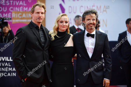 Stock Image of Dutch director Jouri Smit, British actress Sophie Turner and US producer David Atrakchi arrive on the red carpet prior to the premiere of 'Heavy' during the 45th Deauville American Film Festival, in Deauville, France, 07 September 2019. The festival runs from 06 to 15 September.