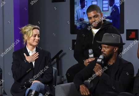 """Brie Larson, O'Shea Jackson Jr., Jamie Foxx. Brie Larson, from left, and O'Shea Jackson Jr. look on as Jamie Foxx speaks during a press conference for """"Just Mercy"""" on day three of the Toronto International Film Festival at the TIFF Bell Lightbox, in Toronto"""