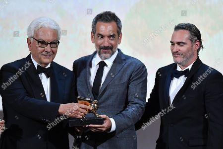 Stock Photo of Venice Biennale President Paolo Baratta (L) and US director Todd Phillips (C) hold the Golden Lion award for the movie 'Joker' as US actor Joaquin Phoenix (R) looks on during the awarding ceremony of the 76th annual Venice International Film Festival, in Venice, Italy, 07 September 2019. The festival runs from 28 August to 07 September.