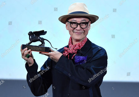 Yonfan holds the Best Screenplay award for his animated movie 'No. 7 Cherry Lane' during the awarding ceremony of the 76th annual Venice International Film Festival, in Venice, Italy, 07 September 2019. The festival runs from 28 August to 07 September.