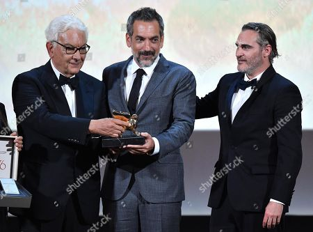 Venice Biennale President Paolo Baratta (L) and US director Todd Phillips (C) hold the Golden Lion award for the movie 'Joker' as US actor Joaquin Phoenix (R) looks on during the awarding ceremony of the 76th annual Venice International Film Festival, in Venice, Italy, 07 September 2019. The festival runs from 28 August to 07 September.