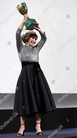 Ariane Ascaride holds up the Volpi Cup (Coppa Volpi) Award for Best Actress for her performance in the movie 'Gloria Mundi' during the awarding ceremony of the 76th annual Venice International Film Festival, in Venice, Italy, 07 September 2019. The festival runs from 28 August to 07 September.
