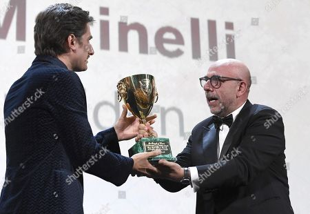 Luca Marinelli (L) with Italian director Paolo Virzi as he receives the Volpi Cup (Coppa Volpi) award for Best Actor for his performance in the movie 'Martin Eden' during the awarding ceremony of the 76th annual Venice International Film Festival, in Venice, Italy, 07 September 2019. The festival runs from 28 August to 07 September.
