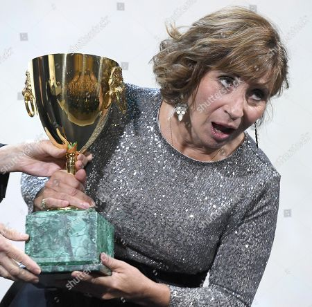 Ariane Ascaride holds the Volpi Cup (Coppa Volpi) Award for Best Actress for her performance in the movie 'Gloria Mundi' during the awarding ceremony of the 76th annual Venice International Film Festival, in Venice, Italy, 07 September 2019. The festival runs from 28 August to 07 September.